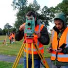 School of Surveying students (from left) Jeremy McCaffrey (20) and Eric Ko (21) work with a total...