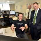 Scott Technology engineer Mike Diment shows Prime Minister John Key what he is working on, while...
