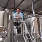 Scotts Brewing Co owner Phillip Scott, of Oamaru, views the brewery's new enlarged operation at...