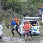Canyoners arrive at the scene in Motatapu Gorge.