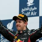 Sebastian Vettel of Germany celebrates on the podium after winning the Bahrain F1 Grand Prix at...