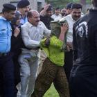 Security officials surrounding Rimsha Masih, in the green scarf, a Christian girl accused of...