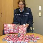 Senior Constable Beth Fookes displays the  Kush Pink seized by police. Photo by Christina McDonald.