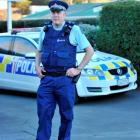 Senior constable Fred Jansen models the new trousers he is trialling outside the Green Island...