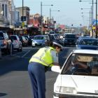 Senior Constable Toni Wall talks to the driver of a vehicle on King Edward St, South Dunedin,...
