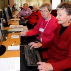 SeniorNet tutor Val Steele (second from right) guides Mavora Kelly  at a computer class in Green...