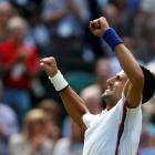 Serbia's Novak Djokovic celebrates after defeating France's Jo-Wilfried Tsonga in their men's...