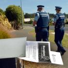 Sergeant James Ure and Constable Gwen Brazier walk around the Dunedin suburb of Fairfield...
