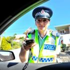 Sergeant Tania Baron, in charge of the Dunedin strategic traffic unit, breath-tests drivers at a...