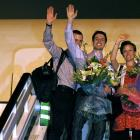 Shane Bauer (L), Josh Fattal (C) and Sarah Shourd wave before boarding a flight in Oman back to...