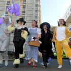 Shania Fox (centre) dresses as Dorothy from the Wizard of Oz, to celebrate her last chemotherapy...
