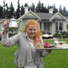 Sheena Haywood stands outside her Laurel Bank House home with treats that will be available at...