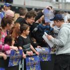 Shield hero Hayden Parker signs autographs at Forsyth Barr Stadium yesterday. Photo by Craig Baxter.