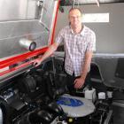 Shotover Jet boat maintenance manager Brett Dingle beside the new V8 Mercruiser engines the...