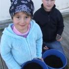 Shyla Geary (5) and Flynn Aitcheson-Green (10) prepare for the Spud in a Bucket programme at...