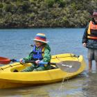 Siblings Efa and Sef Johnston play on the Taieri River after a day spent adventuring in its lower...