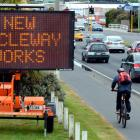 Signs anticipating cycleway construction appeared on Portsmouth Dr yesterday. Photo by Gerard O...