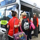 Silverstream School pupils board the Reid Park-North Taieri school bus as teacher Angela...