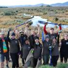 Sinclair Wetlands co-ordinator Glen Riley (left) with a group of voluntourists giving a fortnight...