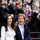 Singer Paul McCartney and his bride Nancy Shevell leave after their marriage ceremony at Old...