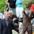 Sir Peter Snell unveils a statue of himself last August recognising his world record-setting mile...