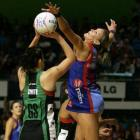 Mystics defender Leana de Bruin (right) stretches out against Nikala Smith, of the Fever, during...