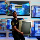 Smiths City Andersons Bay manager Vick Veera  holds an unwanted television, the first set...