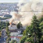 Smoke from the fire billows over Dunedin's southern suburbs. Photos by Stephen Jaquiery and Jane...