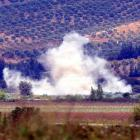 Smoke rises after a mortar bomb fired from Syria landed in Turkish soil on the Turkish-Syrian...