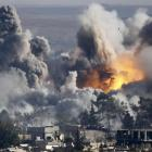 Smoke rises over the Syrian town of Kobani after an air strike from the US-led military coalition...
