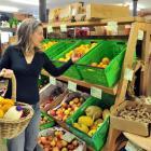 Soil and Health Association Dunedin spokeswoman Philippa Jamieson shops for non-genetically...