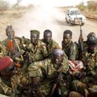 Soldiers of South Sudan's army, or the SPLA, ride in a truck on the frontline with Sudan last...