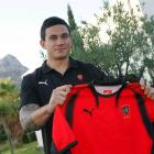 Sonny Bill Williams signs for French Rugby Union side Toulon yesterday. Photo by NZPA.