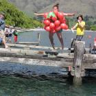 Sophie Fenn (12), of Wanaka, leaps into the lake during the Wanakafest Ray White polar plunge on...