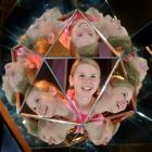 Sophie Warner, of Winton, takes a closer look at a Mirror Magic interactive exhibit at  Otago...