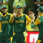 South Africa's AB De Villiers (2nd R) celebrates with team mate Dale Steyn after dismissing...