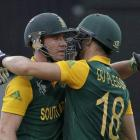 South Africa's AB de Villiers (L) and Faf du Plessis celebrate their 100 run partnership during...