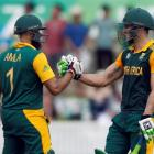 South Africa's Faf du Plessis (R) celebrates with teammate Hashim Amla after reaching his century...
