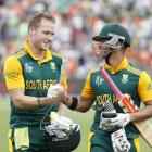 South African batsman JP Duminy (right) and David Miller celebrate both scoring centuries during...