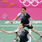 South Korea's women's doubles badminton players Jung Kyung Eun (top) and Kim Ha Na, who are among...