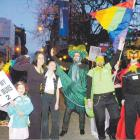 South Murdoch and daughter Aqua Spiers (at left) lead a parade of more than 50 people along...
