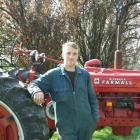 South Otago vintage machinery club secretary Cameron Clark with a 1945 Farmall H vintage tractor....