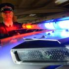 Southern District acting road policing manager Senior Sergeant Steve Larking with a patrol car...