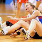 Southern Steel defender Katrina Grant (right) falls to the ground after clashing with Tactix wing...