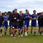 Southern United players warm up before training at Tahuna Park on Thursday night. Photo by Gregor...