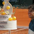 Spain's Rafael Nadal looks at his birthday cake after winning his men's singles match against Kei...