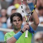 Spain's Rafael Nadal waves to the crowd following his first-round match against Alex Kuznetsov of...