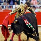 Spanish bullfighter Jose Tomas performs a pass during the last bullfight in Barcelona, at the...