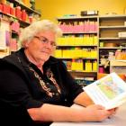 Speld teacher Jean Roulston in the book room at Community House in Dunedin yesterday, with the...