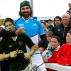 Springbok lock Victor Matfield poses with a cutout picture of fellow lock Bakkies Botha at a...